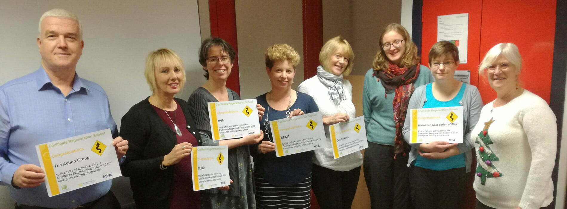 Group of people with certificates